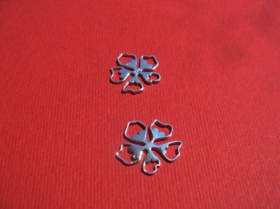 Floare stilizata cu 5 petale din argint .925 rodiat aprox 17x16 mm
